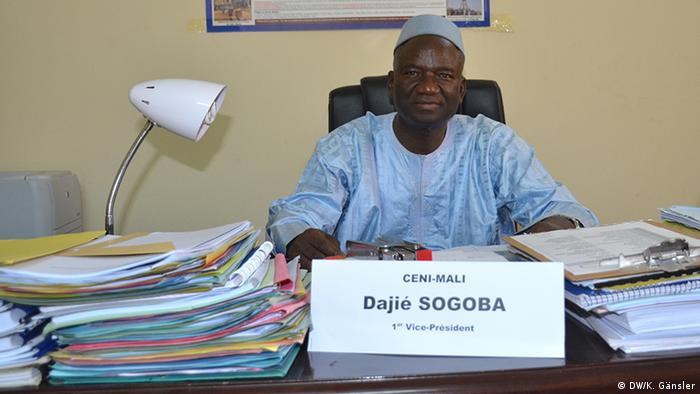 Dajie Sogoba sits at his desk in in Mali