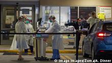 March 12, 2020, Boston, Massachusetts, USA: The Corona Virus, COVID-19, has spread to Massachusetts. With the pandemic gaining more cases, Brigham and Women s Hospital in Boston has opened a drive in testing facility. Here a technician test a person whom has driven up. Boston USA - ZUMAd211 20200312zapd211001 Copyright: xAllisonxDinnerx