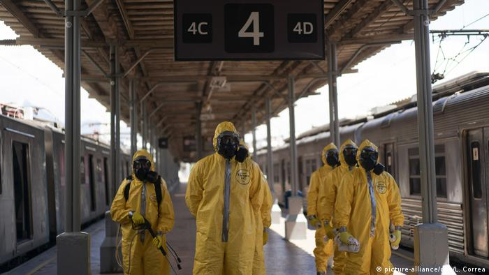 Soldiers in hazmat suits prepare ready for working disinfecting Rio de Janeiro's main train station