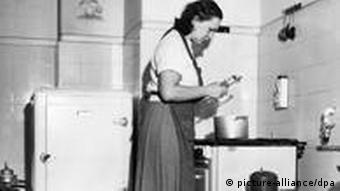 Black and white photo form 1948 of a woman in the kitchen