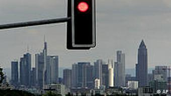 A red traffic light over the skyline in Frankfurt, central Germany.