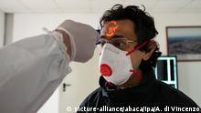 Coronavirus in Italien Temperatur-Messung