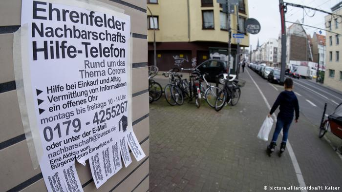 A notice, offering support for elderly people, on a wall in Cologne