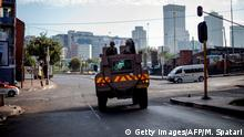 A South African National Defence Force (SANDF) Armoured Personal Carrier (APC) is seen driving in the Johannesburg CBD during an operation to enforce a national lockdown, on March 27, 2020. - South Africa came under a nationwide lockdown on March 27, 2020, joining other African countries imposing strict curfews and shutdowns in an attempt to halt the spread of the COVID-19 coronavirus across the continent. (Photo by Michele Spatari / AFP) (Photo by MICHELE SPATARI/AFP via Getty Images)