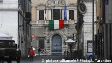 The Italian flag hangs from the balcony of the French Embassy in Rome