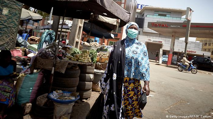 A Malian woman wears a mask as a preventive measure against the spread of COVID-19 coronavirus in the central market of Bamako