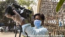 DHAKA, BANGLADESH - MARCH 20 : Bangladeshi journalist with face mask works amid coronavirus (Covid-19) outbreak in Dhaka, Bangladesh on March 20, 2020. Bangladesh has confirmed 20 cases, with one death due to coronavirus (Covid-19), by IEDCR officials. Zakir Hossain Chowdhury / Anadolu Agency