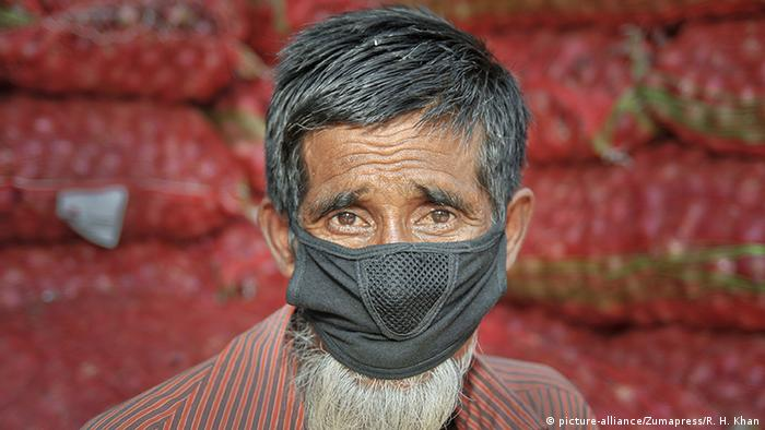 A man wears a mask in the streets of Sylhet, Bangladesh, as a preventive measure against the spread of the coronavirus