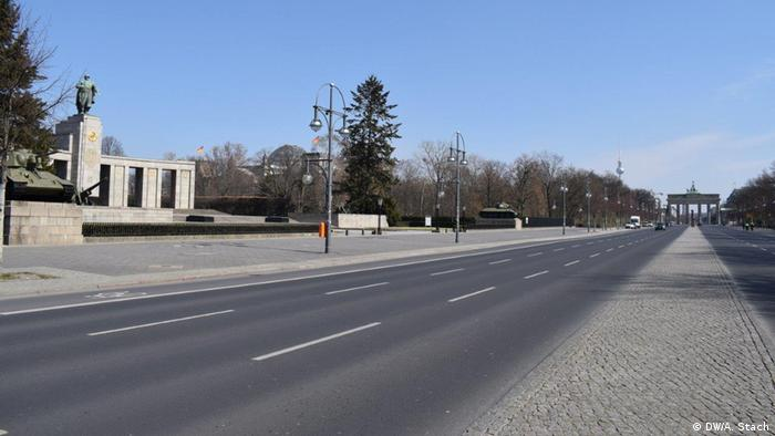 The empty Straße des 17. Juni in Berlin leading to the Brandenburg Gate