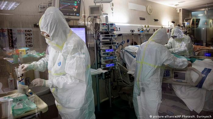 healthcare workers assist a patients at one of the intensive care units (ICU) at German Trias i Pujol hospital in Badalona, in the Barcelona province, Spain