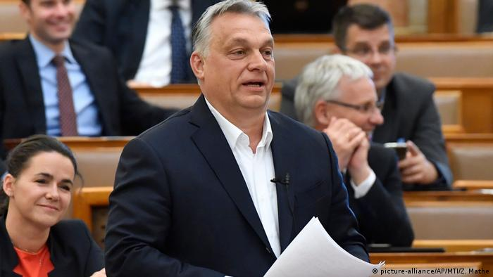 Hungarian Prime Minister Viktor Orban replies to an independent MP during a question and answer session of the Parliament in Budapest, Hungary, Monday, March 30