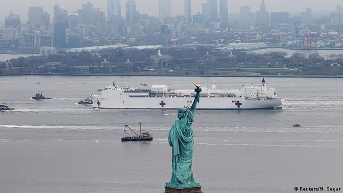 The USNS Comfort passes the Statue of Liberty as it enters New York Harbor