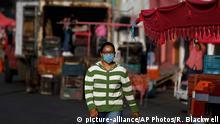 Mexiko Stadt | Coronavirus | Frau mit Mundschutz
