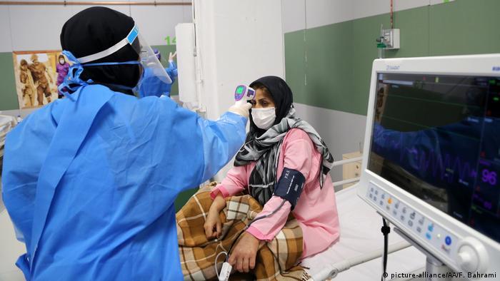 Woman, doctor in makeshift hospital in Tehran