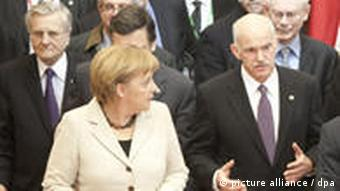 (L-R) German Chancellor Angela Merkel, Greek Prime Minister George A. Papandreou leave the European Union (EU) Council building after a meeting preceeding an informal summit of EU heads of state and government in Brussels, Belgium 11 February 2010. EU leaders will lay the groundwork for a financial rescue of Greece at a summit on 11 February, but any support is likely to require a big commitment from Athens on getting its economy in order. EPA/OLIVIER HOSLET
