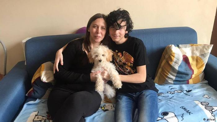 Sonia Tranchina with one of her sons and their dog in their Milan apartment