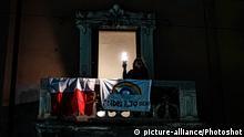 People perform the flash mob 'Illuminiamo l'Italia' (Let's light up Italy) during the national lockdown of Covid-19 Coronavirus in Milan ,ITALY-15-03-2020  