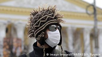 man in a face mask in a street in Ryazan