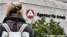 Young woman on the way to the employment agency Cologne (Imago/imagebroker)