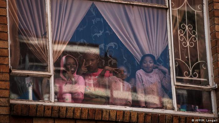 Children look through a window
