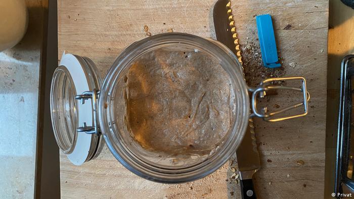 A rye sourdough starter in a glass jar