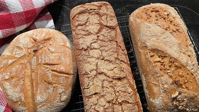 Three fresh loaves of bread, including a sourdough boule, by the author, Zulfikar Abbany