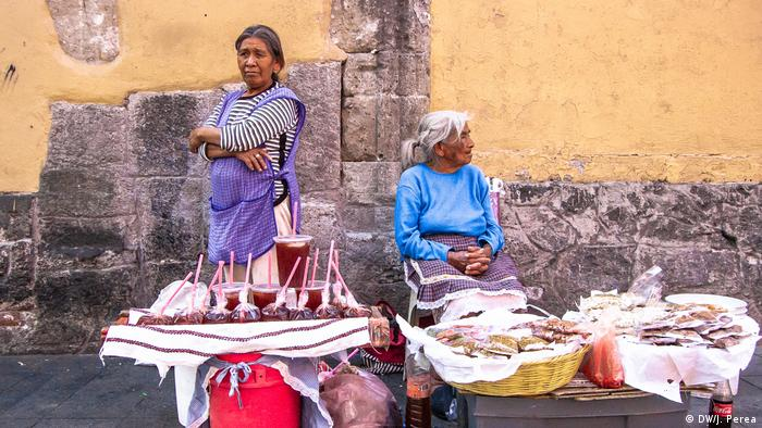 Two women selling their wares in Mexico City