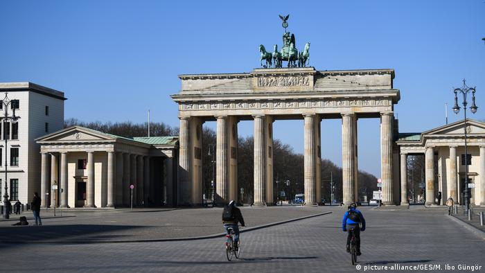 A largely empty square in front fo the Brandenburg Gate in Berlin