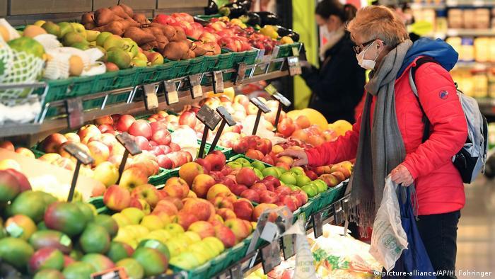 Austria shopper with mask in supermarket