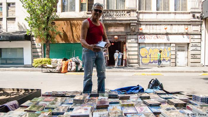 A street vendor selling DVDs in Mexico City
