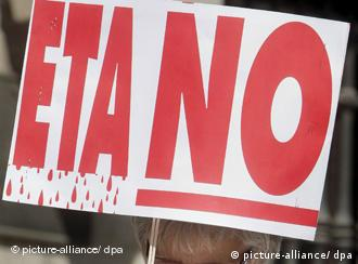 A demonstrator holds a poster against ETA during a rally at Plaza de la Villa de Madrid square, Madrid, Spain, which marks the 50th anniversary of foundation of the Basque terrorist group. Two Spanish Civil guards died in an explosion caused by ETA car bomb in Palmanova one of the most popular tourism sites on Majorca, on 30 July.