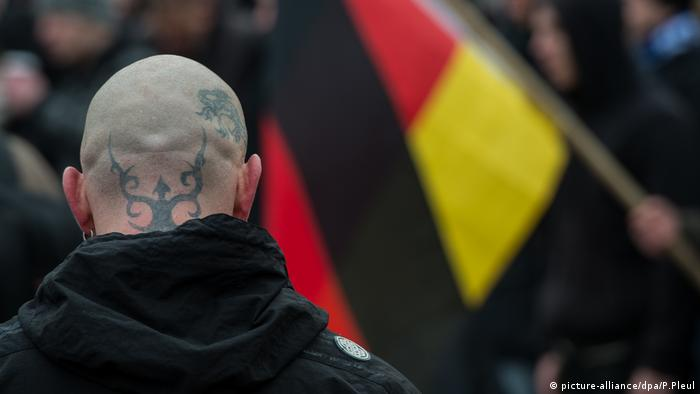 A skinhead at a far-right demo