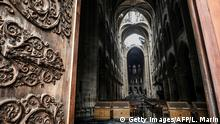 TOPSHOT - A picture taken on April 16, 2019 shows an interior view of the Notre-Dame Cathedral in Paris in the aftermath of a fire that devastated the cathedral. - The Paris fire service announced that the last remnants of the blaze were extinguished on April 16, 15 hours after the fire broke out. Thousands of Parisians and tourists watched in horror from nearby streets on April 15 as flames engulfed the building and rescuers tried to save as much as they could of the cathedral's treasures built up over centuries. (Photo by ludovic MARIN / AFP) (Photo credit should read LUDOVIC MARIN/AFP via Getty Images)
