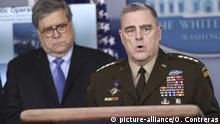 United States Army General Mark A. Milley, Chairman of the Joint Chiefs of Staff speaks during a press conference in the Brady Press Briefing Room of the White House on April 1, 2020 in Washington, DC. Looking on at left is US Attorney General William P. Barr. Credit: Oliver Contreras / Pool via CNP / MediaPunch |