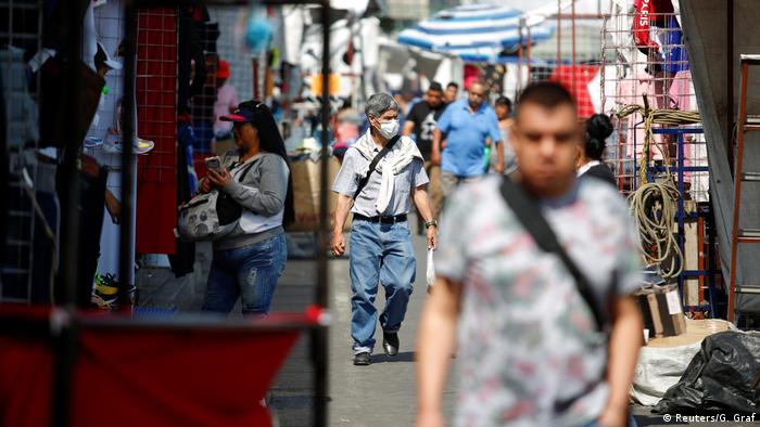 Some people wearing masks at Tepito market in Mexico City during coronavirus outbreak