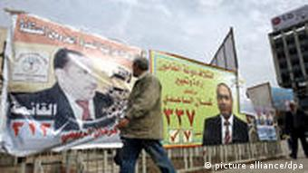 A man walking past an election campaign poster