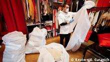Ukrainian fashion designer Ivan Frolov inspects a medical protective coverall in his show room in Kiev, Ukraine April 1, 2020. Designer Frolov postponed his work on a new collection and dedicated all of his resources to sewing protective coveralls for doctors, who keep providing medical services to patients affected by coronavirus disease (COVID-19). Picture taken April 1, 2020. REUTERS/Gleb Garanich