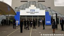 NHS staff gather ahead of the opening of the NHS of the NHS Nightingale Hospital at the ExCel centre, due to the spread of coronavirus disease (COVID-19), in London, Britain April 3, 2020. Stefan Rousseau/Pool via REUTERS