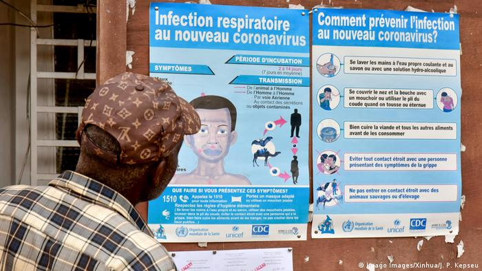 COVID-19 information poster in Yaounde (Imago Images/Xinhua/J. P. Kepseu)