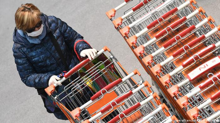 A woman with a shopping cart
