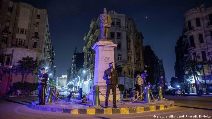 Egyptian security forces enforce a curfew in Cairo