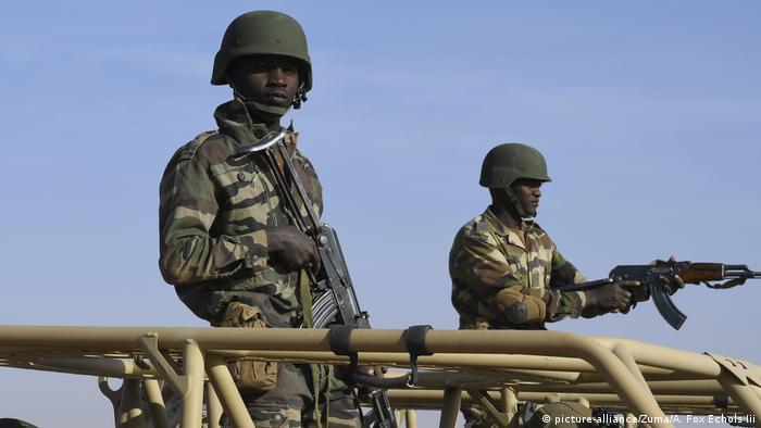 Nigerien soldiers aboard a truck
