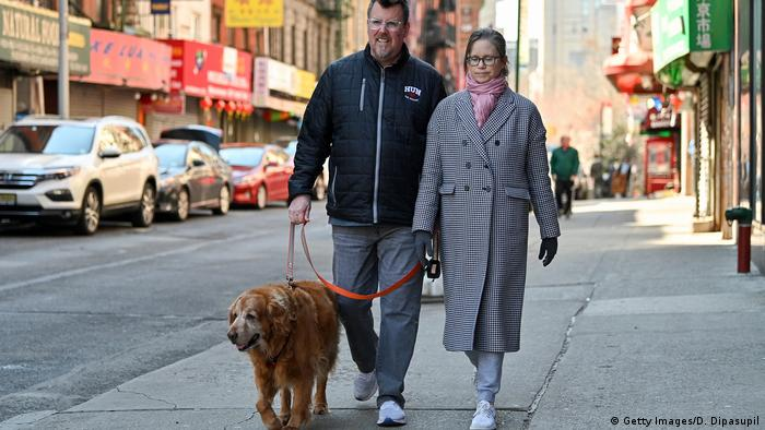 US couple walking their dog
