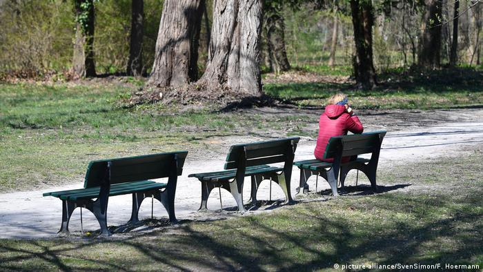 Woman sitting on a bench in Munich park