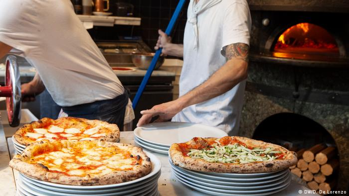 Inside a pizzeria making traditional Neapolitan-style pizza
