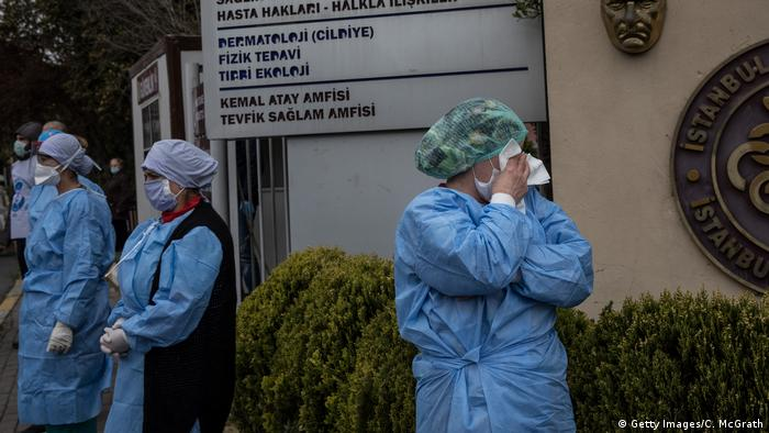Health care workers mourn outside the entrance of the Istanbul Faculty on Medicine