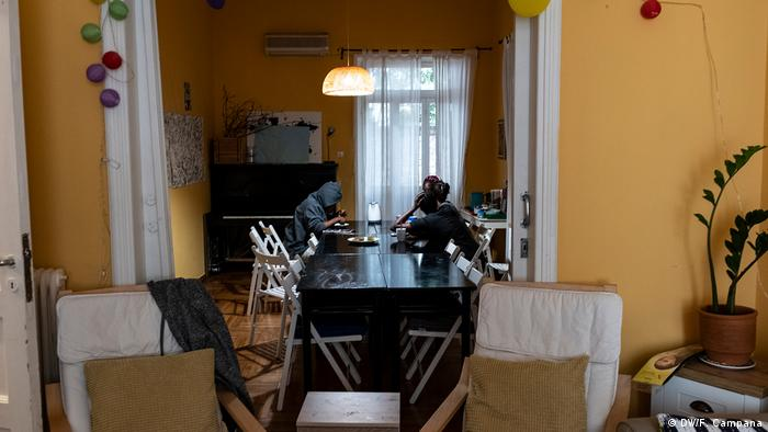 Young asylum-seekers eat breakfast in the dining room at a shelter for unaccompanied minors in Athens run by the HOME Project