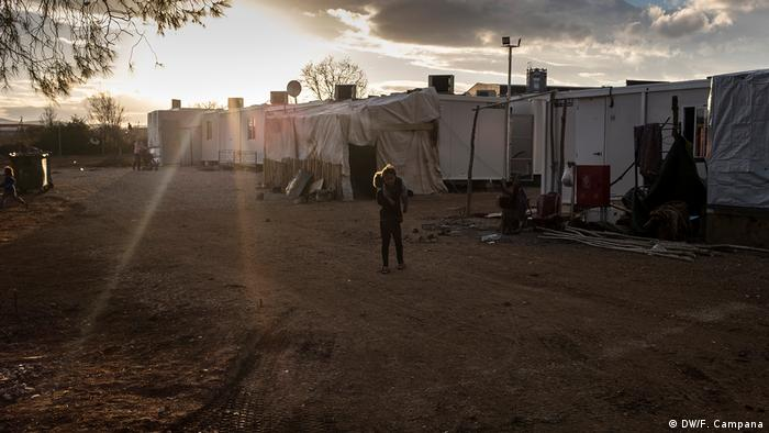 Children play outside at the Ritsona refugee and migrant camp near Athens