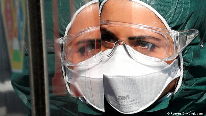 An Italian doctor wearing a protective mask
