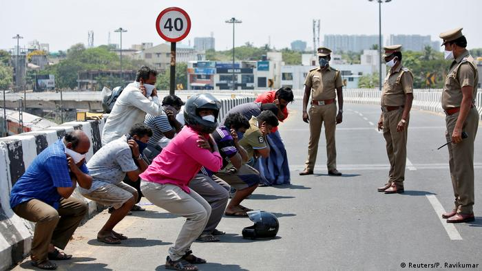 People doing exercises as punishment for breaking lockdown in Chennai, India (Reuters/P. Ravikumar)